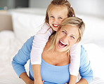 Adorable young girl and mother in a playful mood