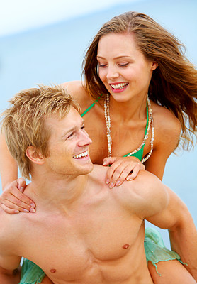 Buy stock photo A young couple having fun on the beach. The concept is: Summer love, romance and a happy lifestyle.