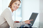 Pretty businesswoman showing something interesting on laptop