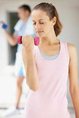 Determined to lose weight - Mature woman working out at the gym