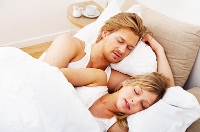 Buy stock photo Young couple sleeping together in bed. A sensual and cute couple.