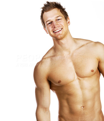 Buy stock photo Attractive young man with a well-defined torso smiling while isolated on white