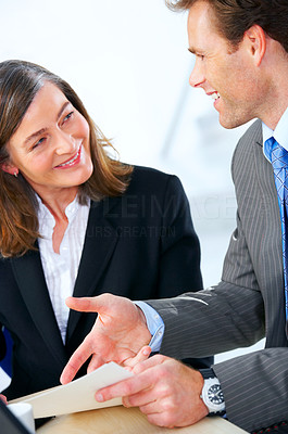 Buy stock photo Business team at a meeting in a light and modern office setting.