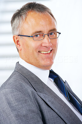 Buy stock photo Close-up portrait of a cheerful senior business man in an office