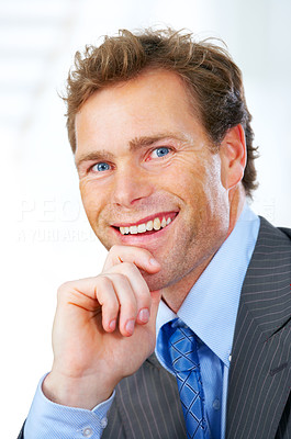 Buy stock photo Confident mature businessman smiling and sitting comfortably