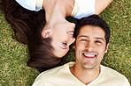 Relaxed couple on grass