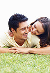 Loving man and woman on grass