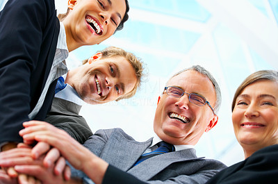 Buy stock photo Handshake and teamwork. A group of buiness people shaking hands in a light and modern office.