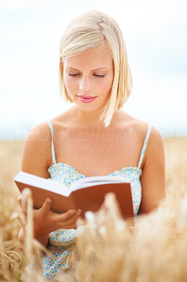 Into her book and in tune with nature