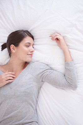 Sweet Dreams - pretty young woman smiling in her dreams