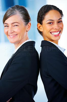 Buy stock photo Business women standing back to back