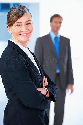 Buy stock photo Business team and a leader - Mature business woman with her colleagues in the background