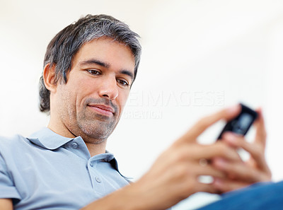 Businessman typing text message on his cell phone