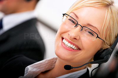 Buy stock photo A friendly telephone operator in an office.
