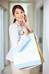 Elegant woman speaking on the cellphone while at shopping