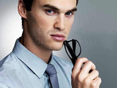 Buy stock photo Portrait of a thoughtful male executive against a grey background