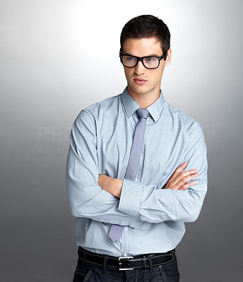 Buy stock photo Portrait of a successful young male entrepreneur looking away in thought grey background