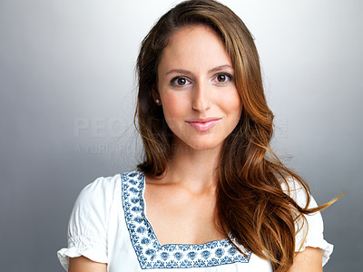 Buy stock photo Portrait of a pretty young female looking at you against grey background