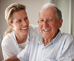 Closeup of a happy old man on the wheel chair with a nurse