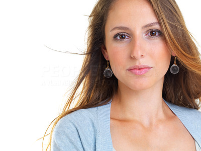 Buy stock photo Closeup portrait of a pretty young girl looking at you against white background