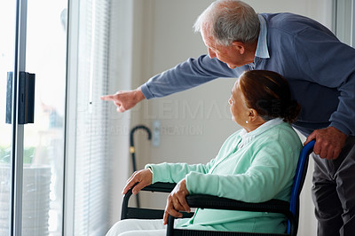 Old woman on a wheel chair , man pointing outside