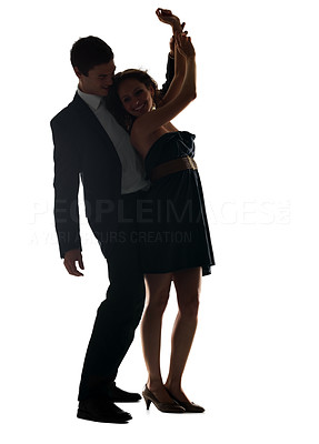 Buy stock photo Portrait of a happy young couple dancing together over white background