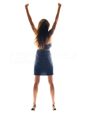 Buy stock photo Rear view of a young woman standing with raised arms over white  background