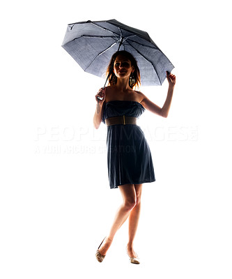 Buy stock photo Portrait of a cute young lady standing under umbrella against white background