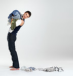 Happy young man carrying clothes in laundry