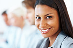Beautiful young businesswoman smiling in a meeting