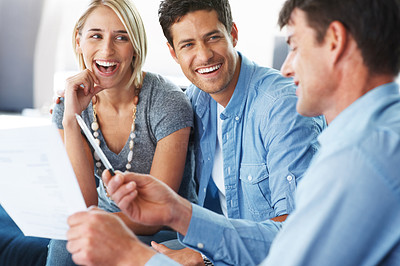 Insurance agent showing new investment scheme to a young couple