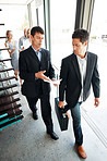 Businesspeople discussing new project while walking