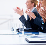 Business people clapping their hands at a meeting