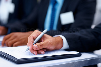 Closeup of a business man filling form at the meeting