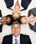 Successful group of business people lying on the floor