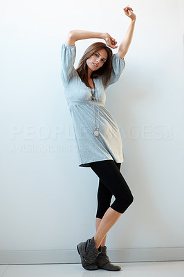 Buy stock photo Pretty young woman posing against a white wall