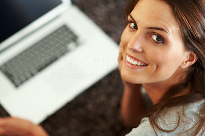 Buy stock photo Beautiful young woman looking up at you while lyin