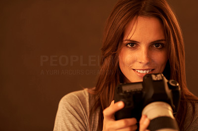 Buy stock photo Portrait of pretty happy young lady with a camera
