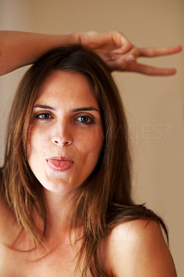 Buy stock photo Closeup of a funny young woman jerking around