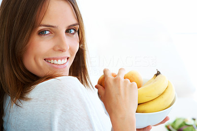 Buy stock photo Pretty young woman holding a fruit bowl