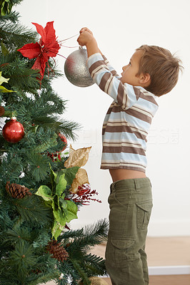 He\'s decorating the tree on his own this year