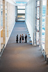 High angle view of business associates together at a hallway