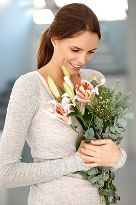 Buy stock photo Smiling young lady holding flower bouquet
