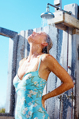 Woman under the shower, outdoors