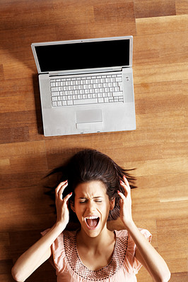 Buy stock photo Frustration - Young woman shouting with laptop
