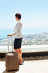 Business woman standing with a luggage bag