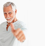 Portrait of a happy old man showing a thumbs up on white