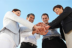 Business people with their hands on top of each other