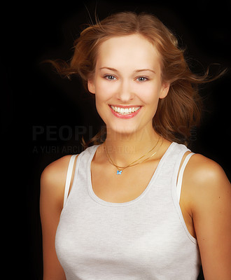 Buy stock photo Smiling casual girl on black background
