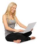 Young Girl Sitting With a Laptop